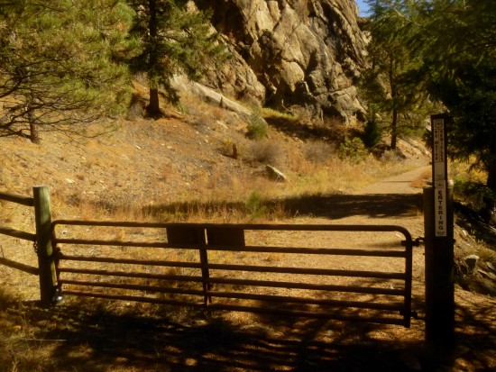 Rusty metal gate marking the end of the park; the trail continues into Pine National Park for 0.3 miles beyond