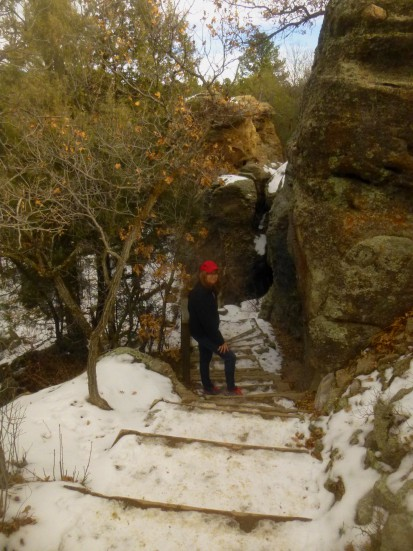 Descending the snowy steps into Castlewood Canyon