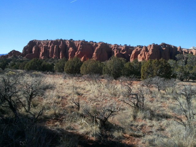 View of red Entrada cliffs to the west, from the Grand Parade Trail