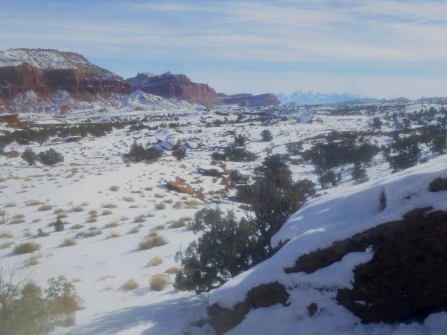 View east from Point 6,230', toward the red-orange cliff walls of Capitol Reef