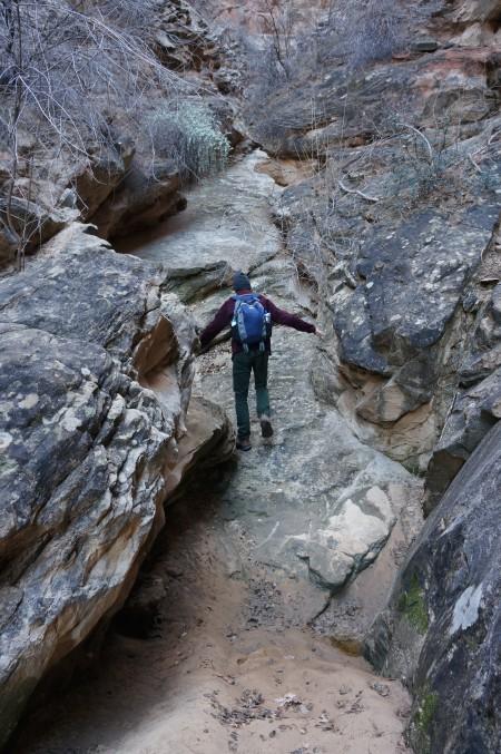 Climbing the strange sandstone ramp, Headquarters Canyon, Capitol Reef National Park