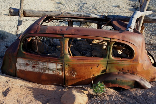 Old tourist car at the Capitol Reef park boundary in Capitol Gorge