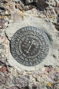 Survey marker at the summit